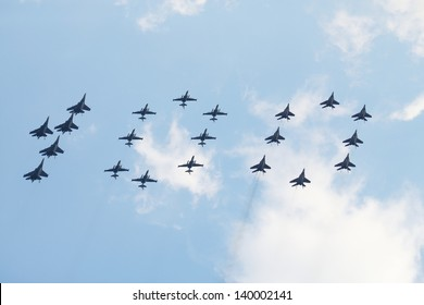 ZHUKOVSKY - AUGUST 12: Group of Su-25, MiG-29 and Su-27 featuring digit 100 at airshow on 100th anniversary of Russian Air Force on August 12, 2012 in Zhukovsky, Moscow region, Russia.