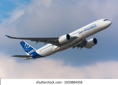 ZHUKOVSKY, MOSCOW REGION, RUSSIA - AUGUST 22, 2015: Airbus Industries A350 perfoming demonstration technical flight in Zhukovsky airport on the cloudy sky background
