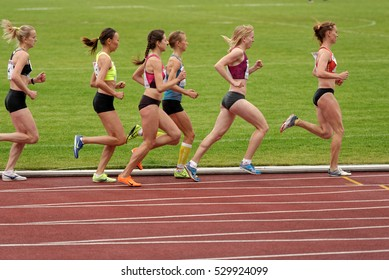 ZHUKOVSKY, MOSCOW REGION, RUSSIA - JUNE 27, 2014: Women compete in 5000 meters during Znamensky Memorial. The competitions is one of the European Athletics Outdoor Classic Meetings
