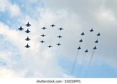 ZHUKOVSKY, RUSSIA - AUGUST 12: different military jets form number 100 during the celebration of the centenary of Russian Air Force on August 12, 2012 in Zhukovsky, Russia
