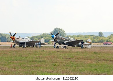 ZHUKOVSKY, RUSSIA - AUGUST 12: P-40 and P-51 historic fighter planes stand on the flight lane during the celebration of the centenary of Russian Air Force on August 12, 2012 in Zhukovsky, Russia