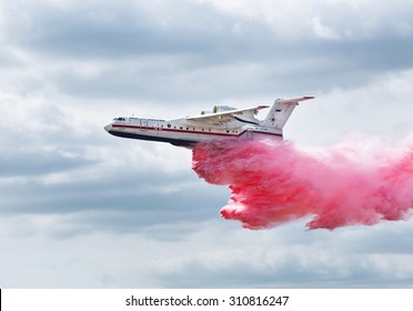 ZHUKOVSKY, RUSSIA - AUGUST 28, 2015: International aviation and space salon in Zhukovsky. Amphibian aircraft B200 flies and demonstrates the discharge of water when extinguishing the fire