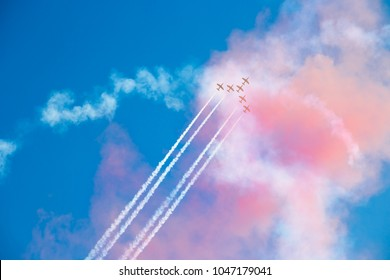 ZHUKOVSKY, RUSSIA - JULY 21 , 2017: The plane with smoke trail against a blue sky with clouds