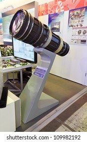 """ZHUKOVSKY, RUSSIA - JUN 29: The international salon of arms and military technology """"Engineering technologies 2012"""" on Jun 29, 2012 in Zhukovsky. Lens with a focal length of 3 meters for spacecraft"""