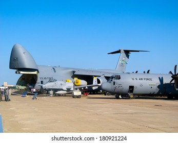 ZHUKOWSKY - AUGUST 16: Lockheed C-5 Galaxy, the military intercontinental cargo strategic aircraft and C-130 Hercules at International Aviation & Space Salon in Moscow MAKS, August 16 2011, Russia.