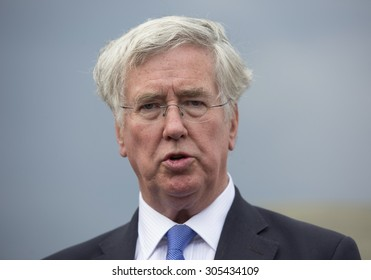 ZHYTOMYR, UKRAINE - AUGUST, 11, 2015: UK Secretary of State for Defence and a member of the National Security Council, Michael Fallon visits a military training ground near Zhytomyr
