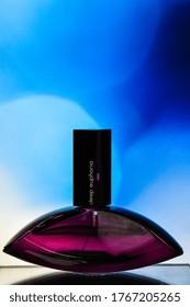 Zhytomyr, Ukraine - June 2, 2020. A bottle of Calvin Klein deep euphoria perfume, fragrance created by Calvin Klein perfume for woman on color background, Female perfume