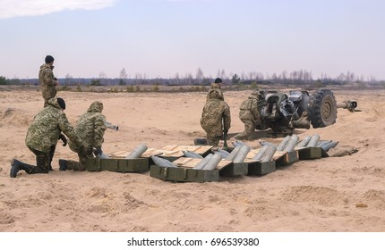 Zhytomyr, Ukraine - March 5, 2015: Front Line. Military attack on battlefield with guns from ambush