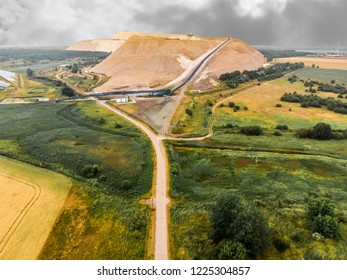 Zielitz, Saxony-Anhalt, Germany, June 3, 2018: Aerial view of the spoil heap of a salt mine of a large company producing fertilizers.