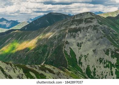 Zig zag hiking trail on top Jarzabczy Wierch (Hruby vrch). Border Poland and Slovakia, Tatras. Carpathian, Europe. Magical mountain landscape. - Shutterstock ID 1842897037