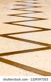 Zig zag line on marble floor.