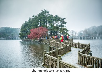 zigzag bridge on the lake with mist and cloud in lushan mountain