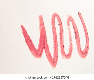 Zigzag lines of pink lipstick, strokes on a white background.