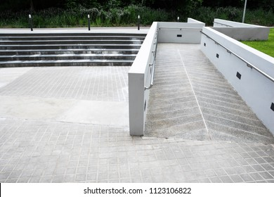 Zigzag ramp for the wheelchair and stairs for normal people adjoining