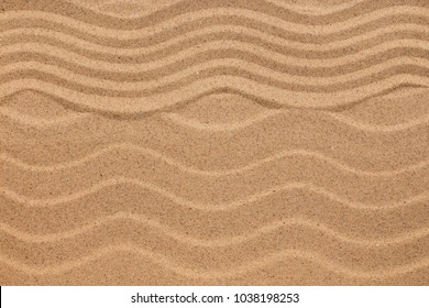 Zigzag and sand dunes, sand texture, background. View from above
