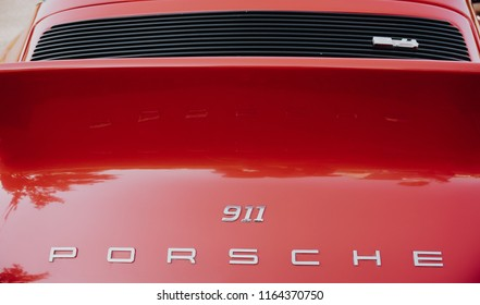 Zilina,  - Slovak Republic, August 4, 2018: A close up image of the red vintage Porsche 911 coupe logo at Old cars exhibition in Zilina city, Slovak Republic