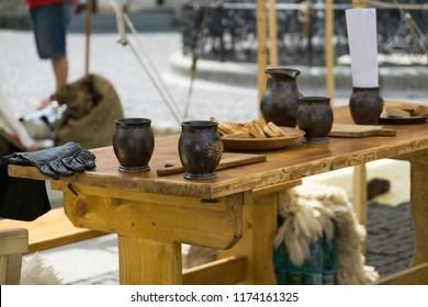 Zilina, Slovakia. 19-Jul-2018: Days of mediaeval art in Zilina. Market: Traditional metal glasses on the table. Slovakia