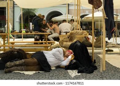 Zilina, Slovakia. 19-Jul-2018: Days of mediaeval art in Zilina. Market: Mediaeval man sleeping on the street. Slovakia