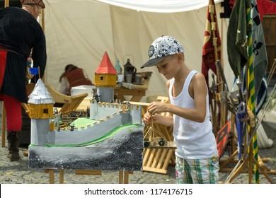 Zilina, Slovakia. 19-Jul-2018: Days of mediaeval art in Zilina. Market:  Boy playing with mediaeval toys. Slovakia