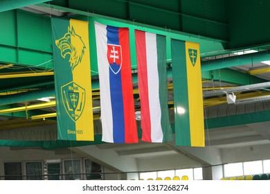 ZILINA, SLOVAKIA - FEBRUARY 16, 2019:   Flags hanging from the roof at the winter stadium in Zilina, Slovakia
