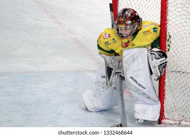 ZILINA, SLOVAKIA - MARCH 6, 2019: Portrait of young goalkeeper of junior Slovak ice hockey team MSHKM Zilina in the net during league match against HK Brezno. MSHKM Zilina won this match 8:2.