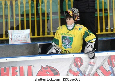 ZILINA, SLOVAKIA - MARCH 6, 2019: Portrait of young goalkeeper of junior Slovak ice hockey team MSHKM Zilina in on the bench during league match against HK Brezno. MSHKM Zilina won this match 8:2.
