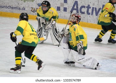 ZILINA, SLOVAKIA - MARCH 6, 2019: Photo of young goalkeeper of junior Slovak ice hockey team MSHKM Zilina during warm up before league match against HK Brezno. MSHKM Zilina won this match 8:2.