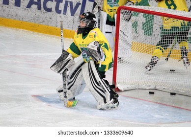 ZILINA, SLOVAKIA - MARCH 6, 2019: Portrait of young goalkeeper of junior Slovak ice hockey team MSHKM Zilina during warm up before league match against HK Brezno. MSHKM Zilina won this match 8:2.