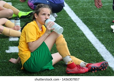 ZILINA, SLOVAKIA - MAY 18,2019: Photo of young girl soccer player of MSK Zilina U15 team at the half time. Refreshment and listening to the coach advices.