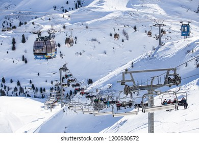 Zillertal, Mayrhofen / Austria. February 06 2014: The snow slopes of the Hintertux Glacier  mountain in the Zillertal Valley, with ski lifts, cable cars, skiers and snowboarders