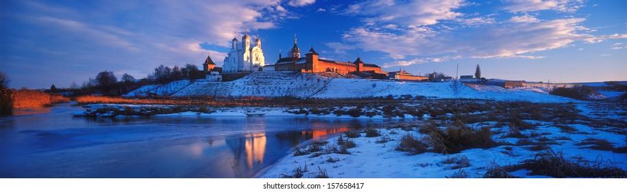 Zimnenskiy Svyatogorskiy the Uspenskiy monastery a beautiful  Ukrainian Orthodox Church of Moscow patriarchy  is placed on  Sainted Hills above background river of Meadow (Lug) near a village Zimno - Shutterstock ID 157658417