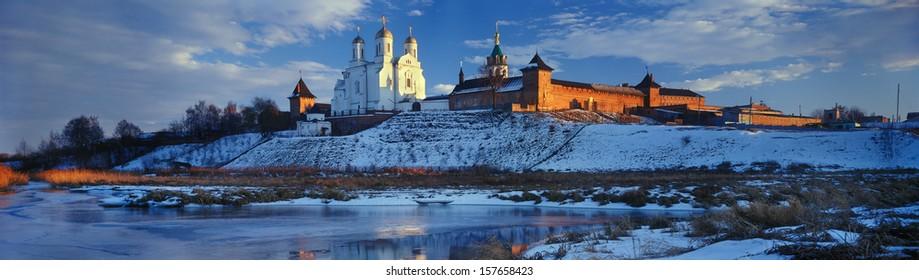 Zimnenskiy Svyatogorskiy the Uspenskiy monastery a?? beautiful  Ukrainian Orthodox Church of Moscow patriarchy  is placed on  Sainted Hills above background river of Meadow (Lug) near a village Zimno - Shutterstock ID 157658423
