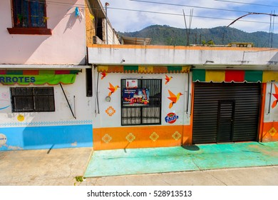 ZINACANTAN, MEXICO - NOV 2, 2016: Architecture of main street in  Zinacantan, state of Chiapas, Mexico. The town is inhabited by the indigenous Tzotzil Maya people