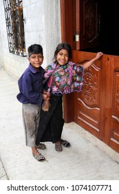 Zinacantan, Mexico - November 8, 2013: A young indigenous Tzotzil Maya girl and boy in traditional dress outside a house in a rural village near San Cristobal de la Casas in the Chiapas state.