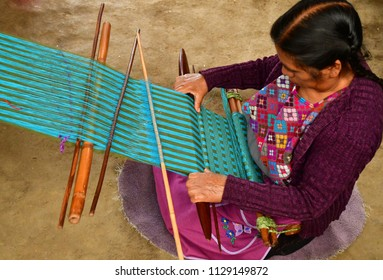 Zinacantan; United Mexican States - may 15 2018 : a weaver in the village centre