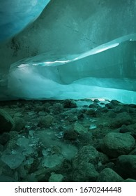 Zinal in Swiss Alps : Eerie green light from within a glacier