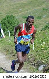 Zinal, SWITZERLAND - AUGUST 7: Elite runner, Petro Mamu (ERI) in the Sierre-Zinal World ChampionshipTrail Race:  August 7, 2021 in Zinal, Switzerland