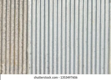 Zinc background. close up to pattern texture vertical zinc sheet. Zinc vintage background view. Wall aluminum silver stainless.