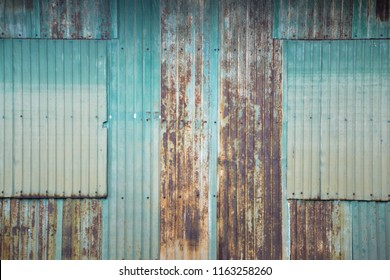 Zinc corrosion, abstract background, Old house wall made of rusty zinc.