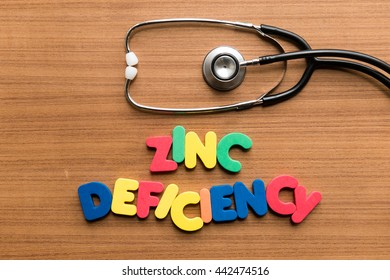 zinc deficiency colorful word with stethoscope on wooden background