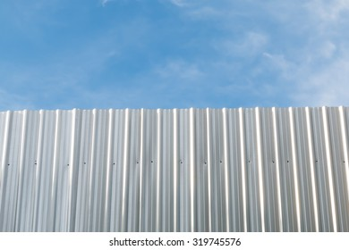 Zinc fence with sky for background