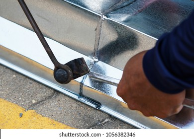 Zinc gutter welding by using soldering copper with picnic gas:Technician is welding aluminium pipe by using soldering copper.