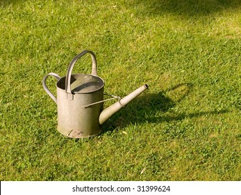 Zinc metal watering can on grass