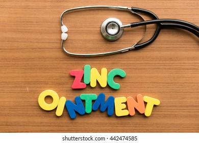zinc ointment colorful word with stethoscope on wooden background