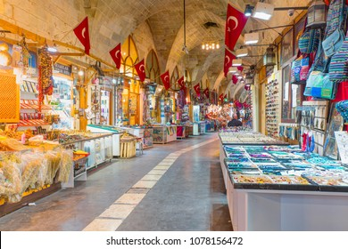 ZINCIRLI BEDESTEN, GAZIANTEP, TURKEY - APRIL 20, 2018: Spice shops in old bazaar of Zincirli Bedesten . Copper decoration, tray,pot coffe ornament, souvenirs, various spices, in front of shop.