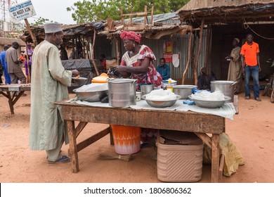 Zinder, Niger - September 2013: African women at village street market stall selling food