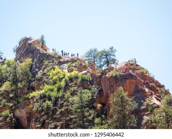 Zion National Park / USA - April 28 2018:  People on the trail to Angel's landing in Zion National park. Travel and adventure concept.