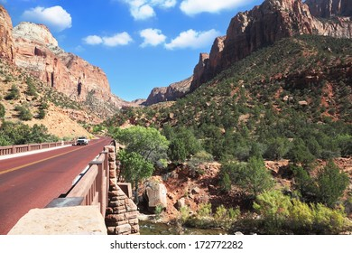 Zion National Park, USA. Excellent with red asphalt road among the picturesque mountains of orange and red sandstone
