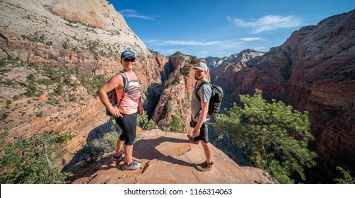 ZION NATIONAL PARK, UTAH/USA 6/15/18: Couple celebrating their summit to the top of Angels Landing, Zion National Park.