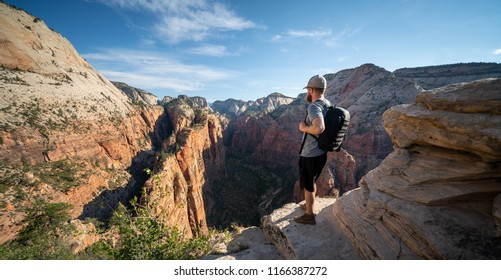 ZION NATIONAL PARK, UTAH/USA 6/15/18: Young man overlooking the path he took to get to the top of Angels Landing, Zion National Park.